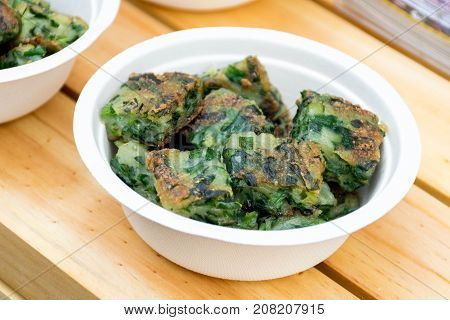 Chinese Traditional Food Fried Chinese Pancake or Fried Steamed Dumpling Made of Garlic Chives