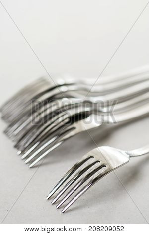 Metal Forks On The White Marble Background Table