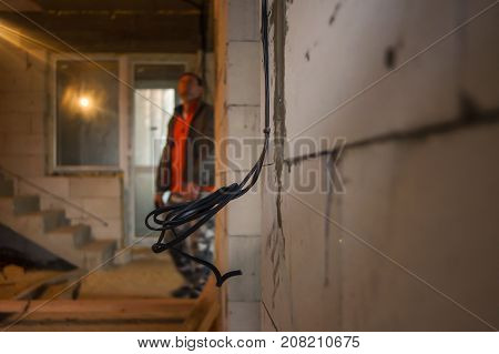 Closeup for wall socket. Electrician with exposed wiring. Exposed electrical wall sockets with the top covers removed for installation of the wiring for a house.