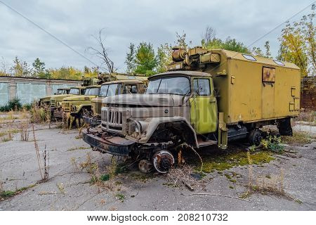 Abandoned Russian military base. Abandoned derelict military trucks
