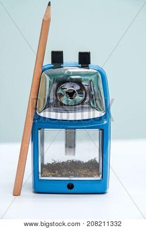 Blue pencil sharpener machine on white background.