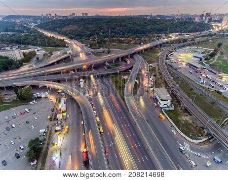 Traffic on freeway interchange. Aerial night view city traffic.