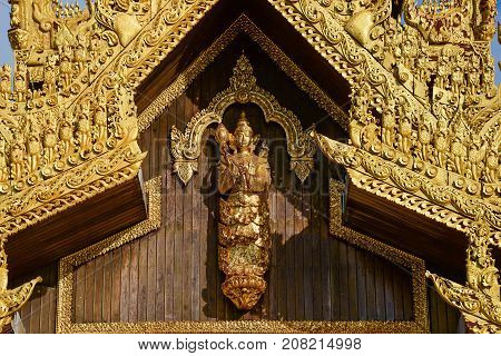 myanmar art wooden craft of angle image on wooden wall at shwedagon pagoda south gate in yangon city.shwedagon pagoda is famous place and important landmark for buddhism and tourist in yangonmyanmar