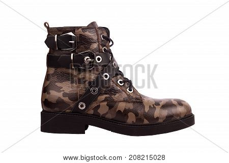 side view of woman high boot with army texture metal buckle and leather straps isolated on white