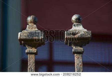 Photo of two metal objects with selective focus and sunlight