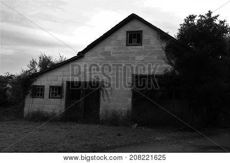 Big empty garage type building near a road