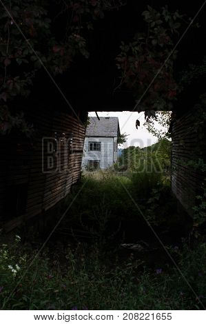 Looking through an old structure to the empty home