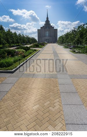 LDS Temple in Kyiv Ukraine with cloudy sky in summer on a sunny day.