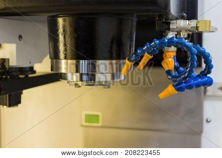 Inside CNC machining Center ; Chuck and Coolant plastic tube;