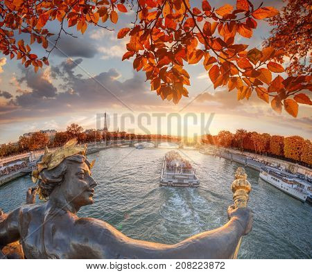 Alexandre Iii Bridge In Paris Against Eiffel Tower With Autumn Leaves, France