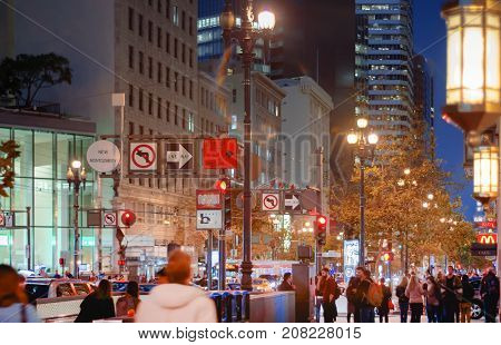 San Francisco CA USA october 22 2016: night scene with crowded street near New Montgomery subway station in San Francisco