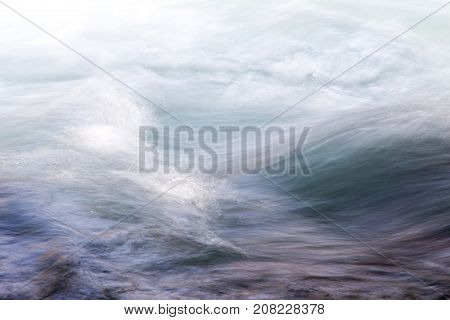 background of turbulent water in the mountain river