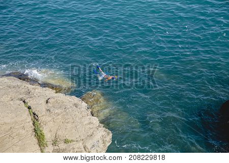 Italy, Liguria' scuba diving in the water, rest on the sea, entertainment, leisure, divers in the sea, a dangerous game, deep blue sea