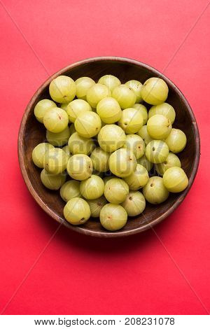 stock photo of Indian gooseberry or Amla (Phyllanthus emblica) in a cane basket, selective focus