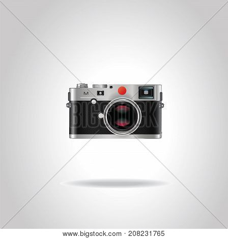 Realistic vintage style retro photo camera with shiny blue lens. Vector illustration isolated on gray
