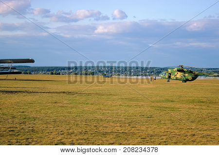 Military Helicopter At Field
