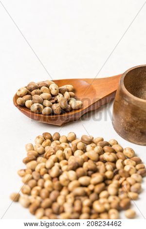 Pile Of Soya Beans With Wooden Spoon On The White Marble Background Table