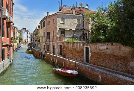 Venice, Italy - July 26th 2017. A residential area in the Dorsoduro quarter of Venice. Despite it being peak season the more residential back streets remain relatively quiet