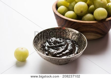 Stock photo of Amla/Avla/Aavla and it's by products like chyawanprash or chyavanprash, selective focus