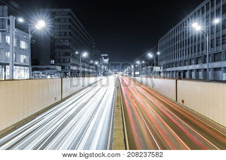 View of transport metropolis traffic and blurry lights of cars on multi-lane highways and road junction at night in Moscow