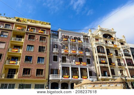 VALENCIA SPAIN - October 7 2017: Buildings are draped with Spanish flags as a gesture against the independence referendum in Catalonia