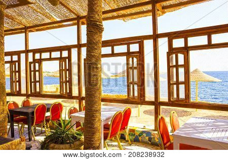 Sharm El Sheikh, Egypt - September 24, 2017: Outdoor restaurant and beach at the luxury hotel at Sharm el Sheikh, Egypt on September 24, 2017
