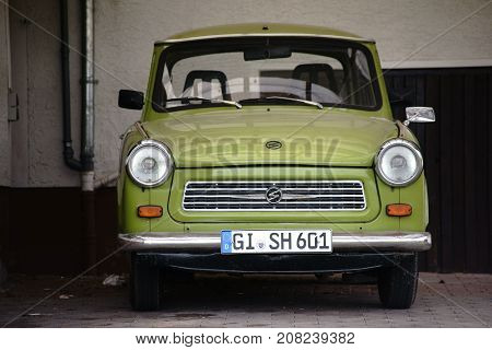 GIESSEN, GERMANY - SEPTEMBER 30: The front view of an old vintage car from the Trabant brand in a parking lot on September 30, 2017 in Giessen.