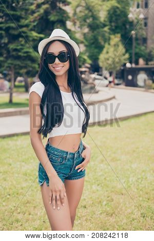 Attractive Cute Carefree Gorgeous Lady With Bronze Skin Is Posing In Sunny Town, On Stroll, In Eyewe