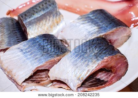 Pieces of fish, Pieces of herring on the plate. Selective focus