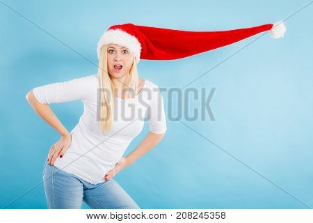 Woman Wearing Windblown Santa Hat
