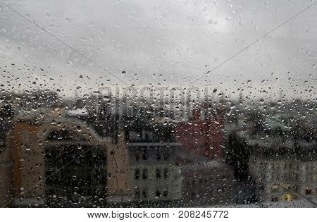 Rain Drop On Clear Glass Window, Reflection Of Blurred City And Light Bokeh From Outside, Beautiful