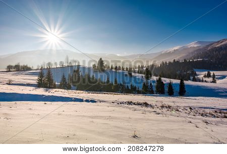 Sun Burst Over The Beautiful Winter Landscape