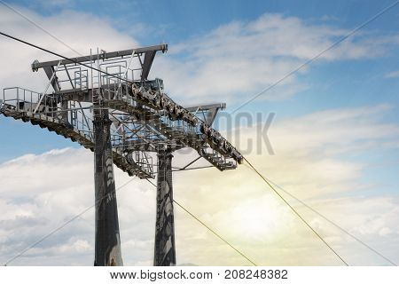 Cable car pylon on the cloudy sky