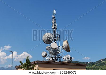 Telecommunication antennas on the roof of the building