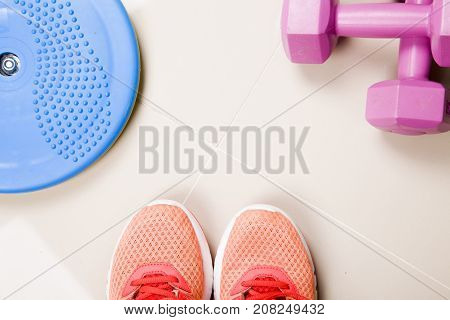 Healthy lifestyle, food, sport or athlete's equipment on bright background.sneakers, weights, fruits, vegetables. Flat lay. Top view with copy space.Fitnes symbols.