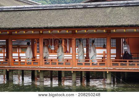 Miyajima, Japan - September 14 2017: Monks With Traditional Clothing In Itsukushima Shrine