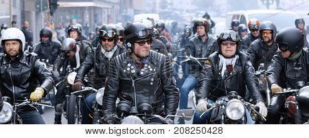 STOCKHOLM SWEDEN - SEPT 02 2017: Many MC drivers in helmets and leather clothes on retro motorcycles waiting to to start driving at the Mods vs Rockers event at the Saint Eriks bridge Stockholm Sweden September 02 2017