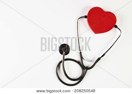 Medical stethoscope and red heart isolated on white background with copy spase. Blood pressure control and heart health care concept