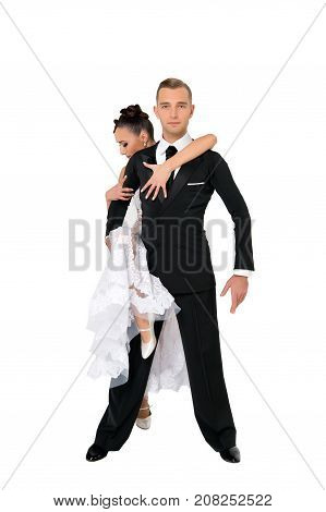 dance ballroom couple in a dance pose isolated on white background. sensual professional dancers dancing walz tango slowfox and quickstep. couple in love romantic concept