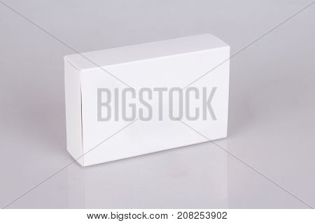 White boxes whith reflection. Mockup ready for your design. Box perspective. Gray background.