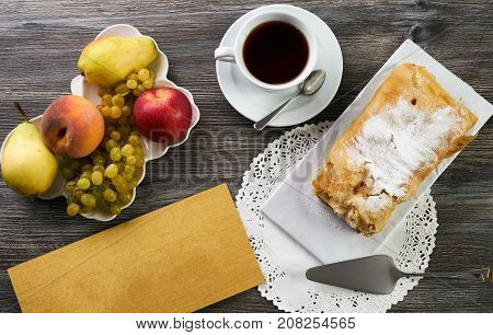 Homemade Apple Strudel With Powdered Sugar And Fresh Apples