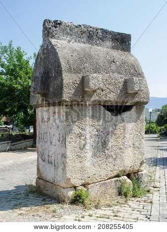 Ancient Lycian tomb in the street of the city of Fethiye. Turkey