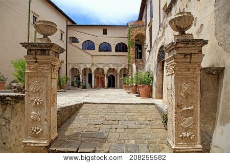PITIGLIANO, ITALY - JULY 26, 2017: Museum in the historic center of gorgeous etruscan and medieval town Pitigliano built of tuff stone, Grosseto, Tuscany, Italy. Called