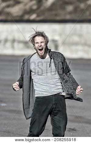 Man With Angry Face Shouting In Sporty Clothes Outdoors
