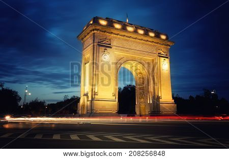 The Triumphal Arch (Arcul de Triumf) in Bucharest the capital of Romania. Historic monument in red yellow and blue the colors of the Romanian flag