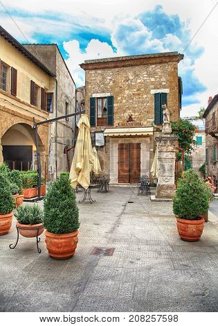 PITIGLIANO, ITALY - JULY 26, 2017: Cafe in the historic center of gorgeous etruscan and medieval town Pitigliano built of tuff stone, Grosseto, Tuscany, Italy. Called