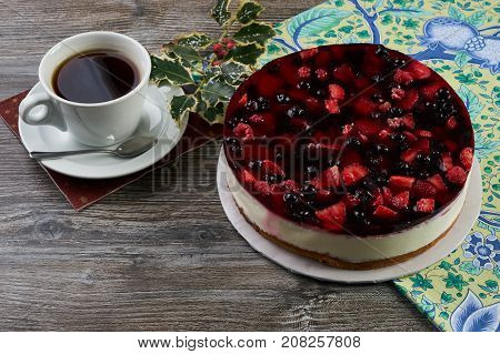 Cheesecake With Berries And Cup Of Tea
