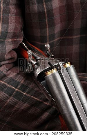 Hunter Hold In Hand Hunting Double Barrel Vintage Shotgun Dressed Jacket In Cell.close-up.copy Space