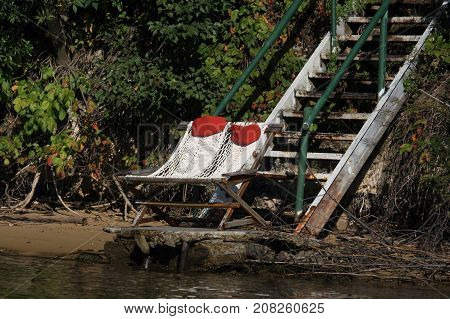 Wooden steps leading down to the shoreline and chairs