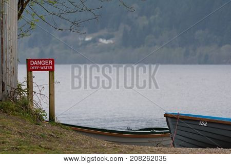 Deep Water Red Sign Near The Loch Ness Lake, Scotland